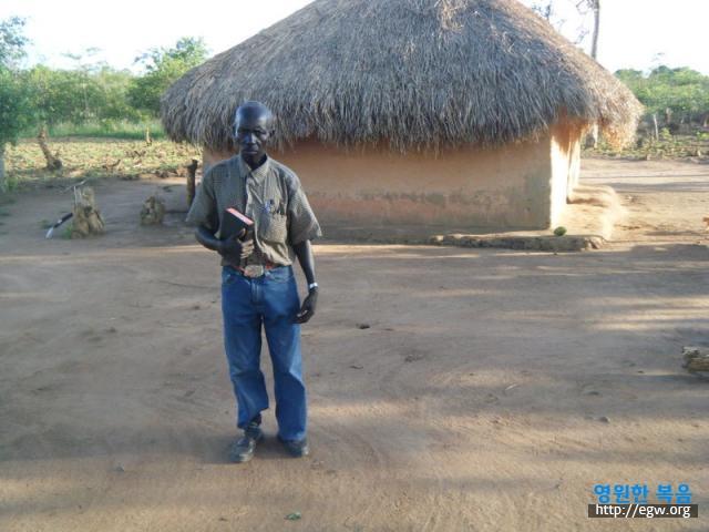 14. Elder John Alemi-Ombanya Br.jpg