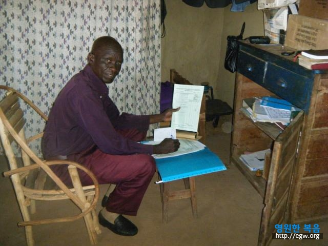 5. Sam in Ingbokolo Office.jpg